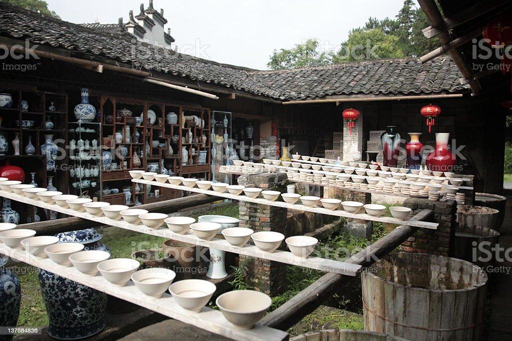 Drying porcelain blanks at Porcelain Workshop in Jingdezhen (景德镇), China stock photo