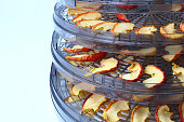 Drying sliced apples at home,  drying rack close-up, copy space.