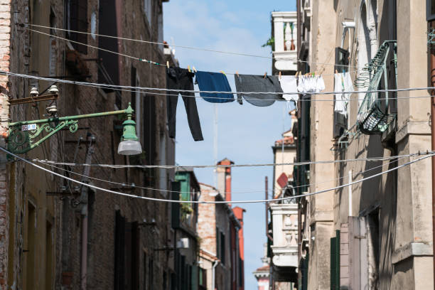 Drying underwear on ropes near walls of antique buildings in Venice, Italy. stock photo
