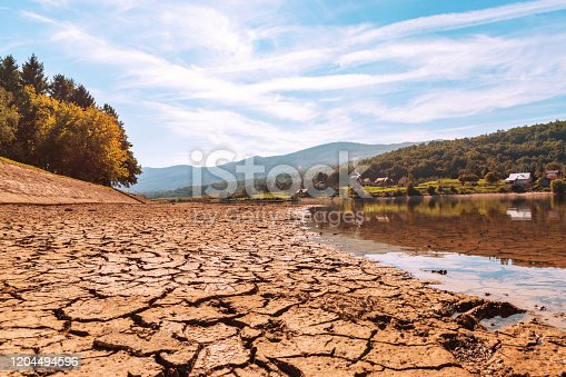 istock Drying up pond, cracked earth. 1204494596
