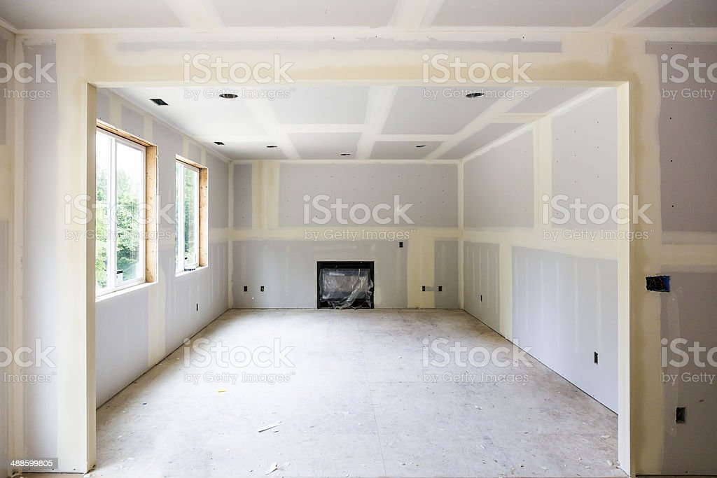 Drywall installation in a new home contruction stock photo