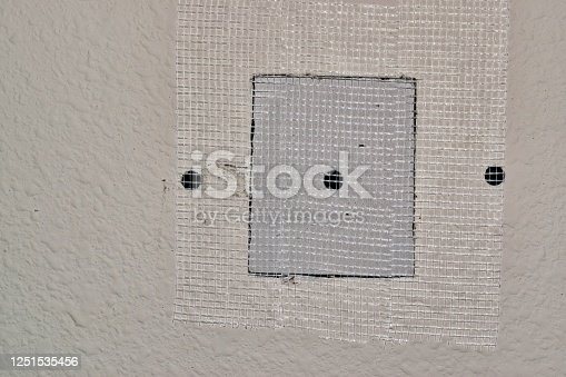 168248826 istock photo Drywall repairs in wall with fiberglass tape. 1251535456