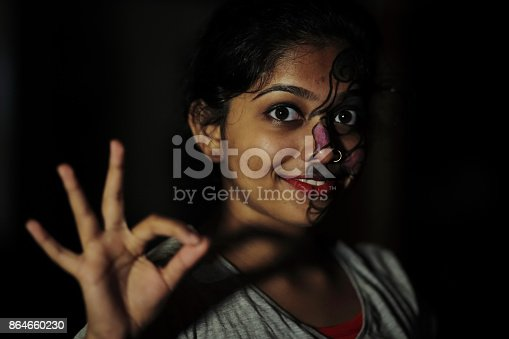 Conceptual image of a female's face representing dual characters or behaviors in human.