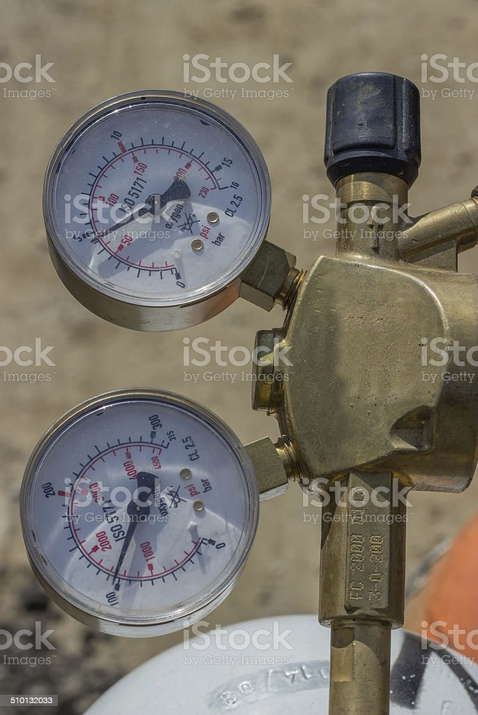 Dual pressure gauges of oxy acetylene tanks stock photo