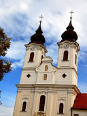 Beautiful Baroque spires of the Benedictine Abbey Church in Tihany, Hungary on the shores of Lake Balaton.