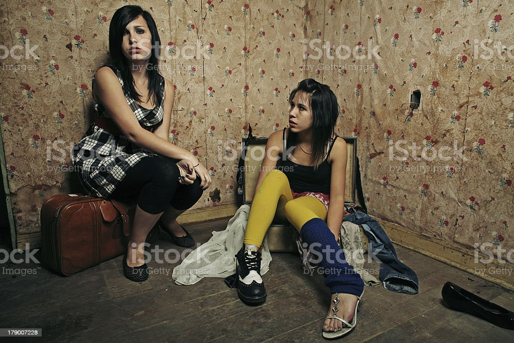 Dual Teen Girls on Retro Wallpaper in Abandoned House royalty-free stock photo