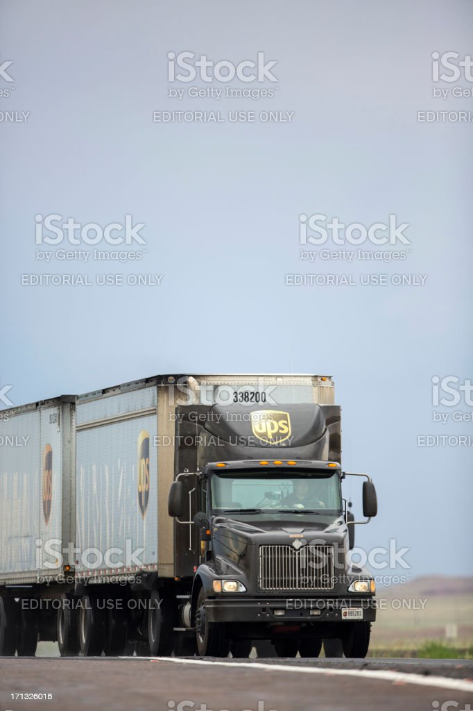 Dual trailer United Parcel Service Rig on interstate stock photo