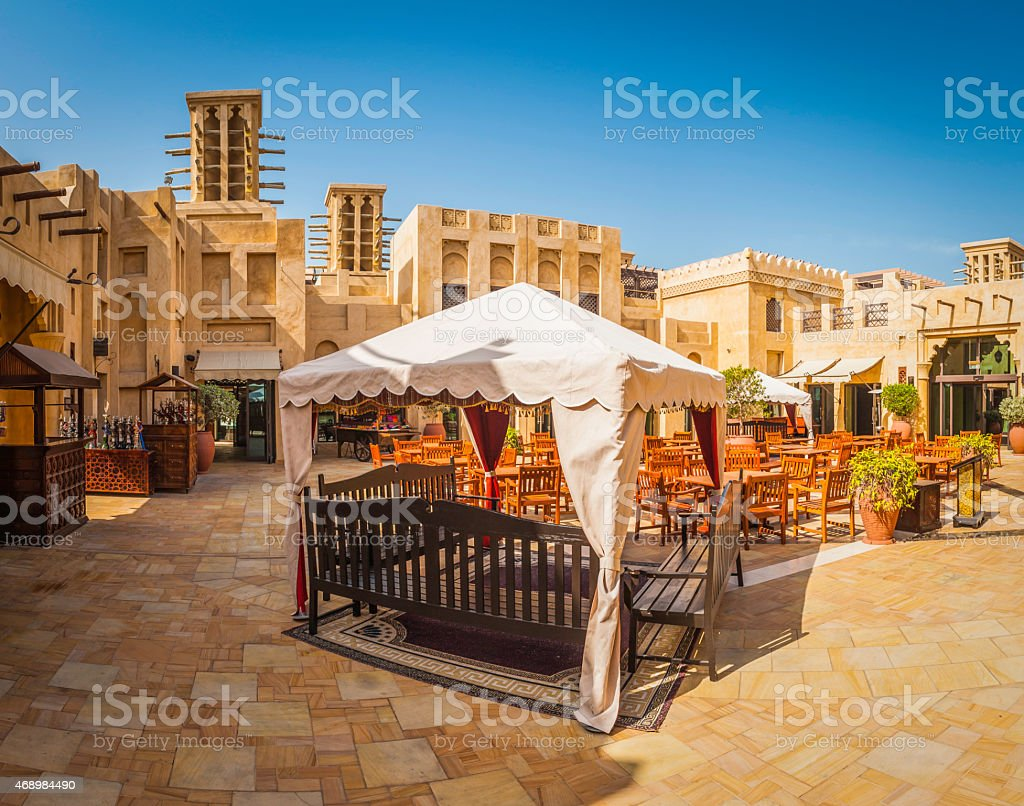 Dubai al fresco restaurant in traditional square wind towers UAE stock photo