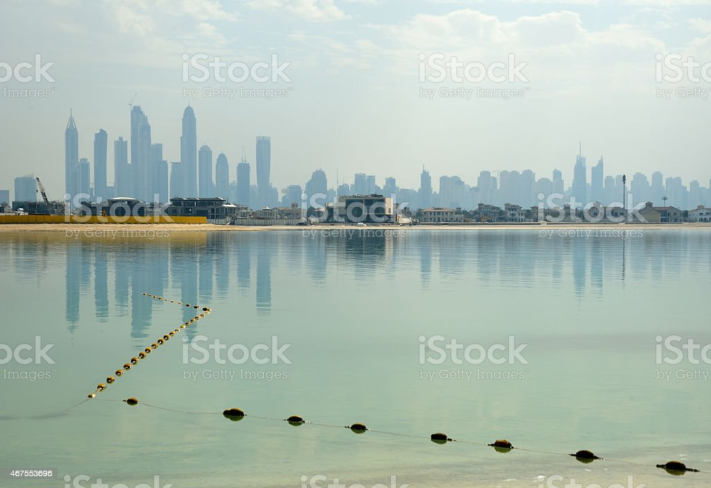 Dubai buildings reflecting in the water stock photo