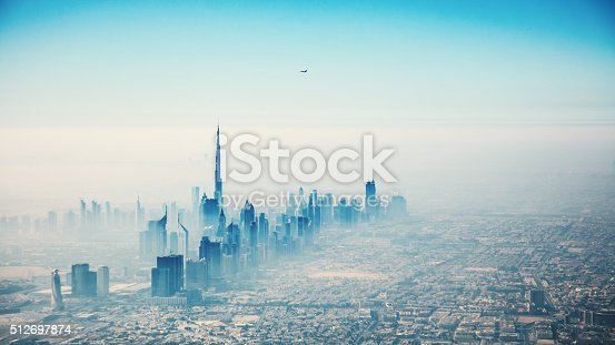 512697874 istock photo Dubai city in sunrise aerial view 512697874