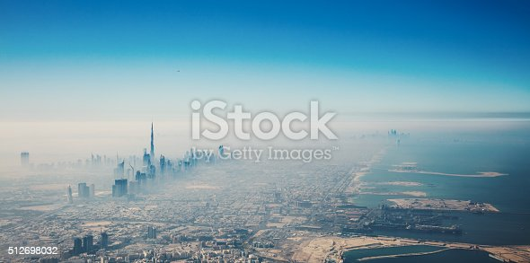 512697874 istock photo Dubai city in sunrise aerial view 512698032