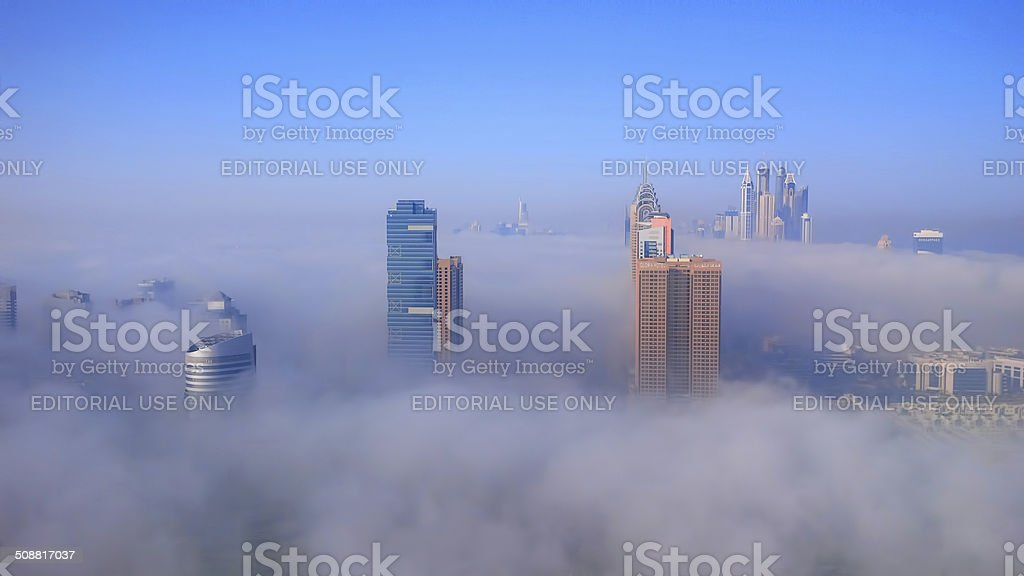 Dubai city is covered by early morning fog stock photo