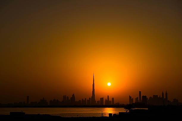 dubai city silhouette at sunset stock photo