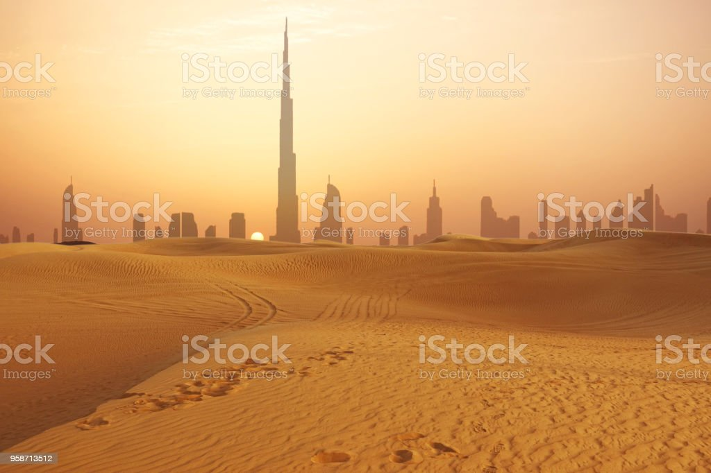 Dubai city skyline at sunset seen from the desert Dubai city skyline at sunset seen from the desert Building Exterior Stock Photo