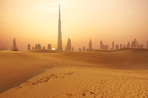 Dubai City Skyline At Sunset Seen From The Desert Stock Photo - Download Image Now