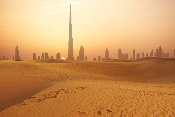 dubai city skyline at sunset seen from the desert - desert stock pictures, royalty-free photos & images
