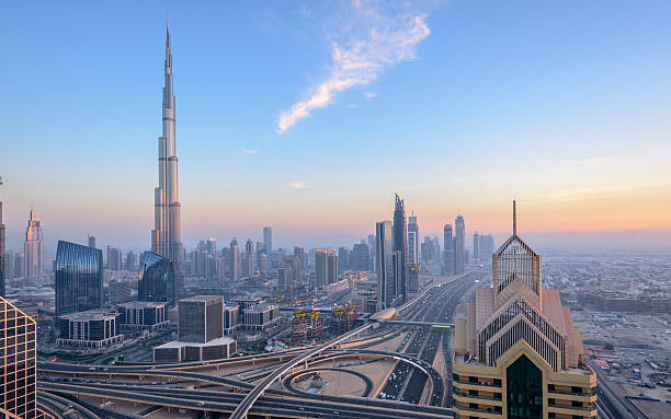Dubai City Skyline Sunset Sunset over Dubai showing Sheik Zayed Road and sunset over city with Burj Khalifa and Downtown business district. UAE. burj khalifa stock pictures, royalty-free photos & images