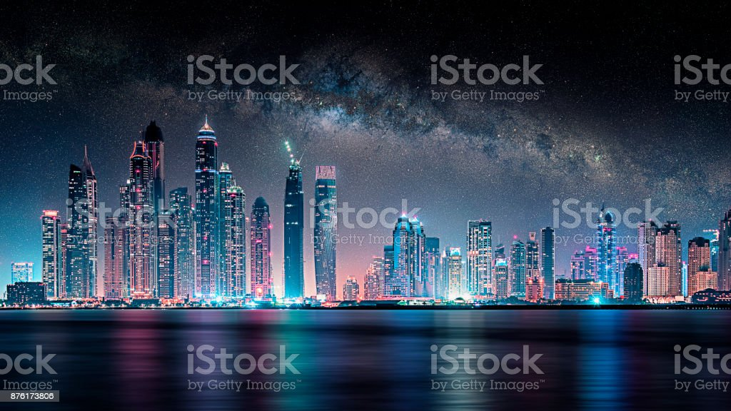 Dubai city under the milky way stock photo