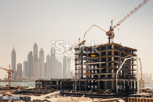 New construction work in Dubai. Marina Dubai district in the background.