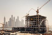 New construction work in Dubai. Marina Dubai district in the background.