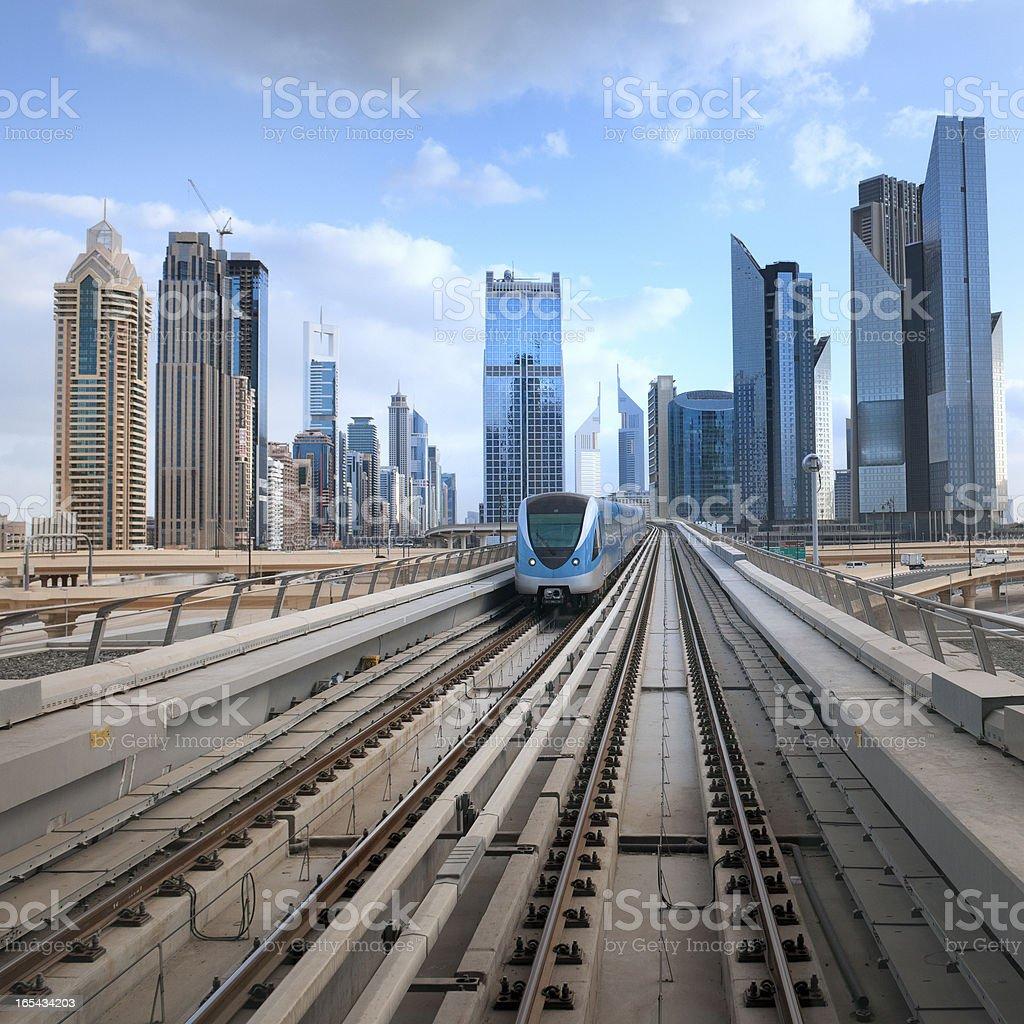 Dubai Downtown cityscape and subway train stock photo