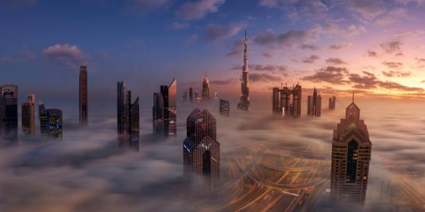 dubai downtown in schönen nebel - dubai stock-fotos und bilder