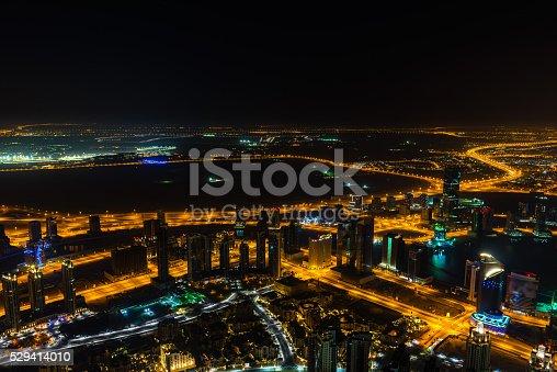 istock Dubai downtown night scene with city lights 529414010