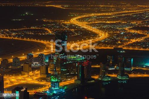 istock Dubai downtown night scene with city lights. Top view 501425740