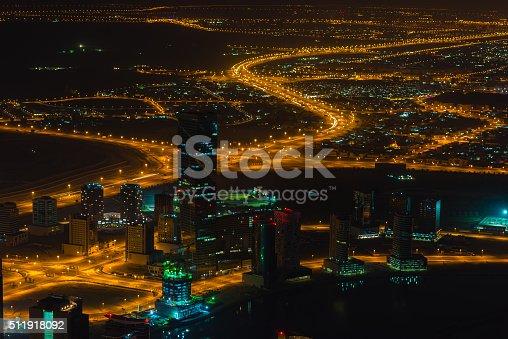 istock Dubai downtown night scene with city lights. Top view 511918092
