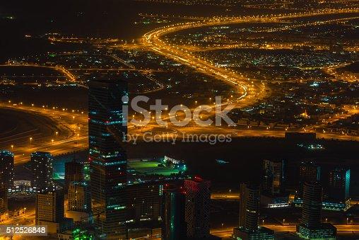 istock Dubai downtown night scene with city lights. Top view 512526848
