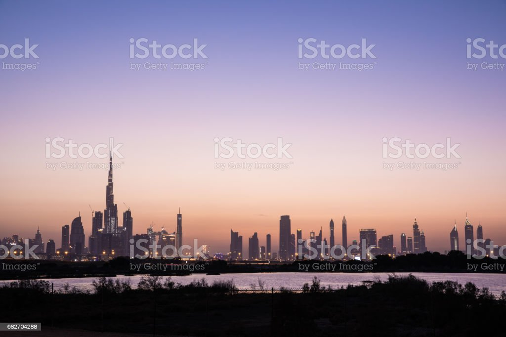 Dubai Downtown skyline at sunset. stock photo