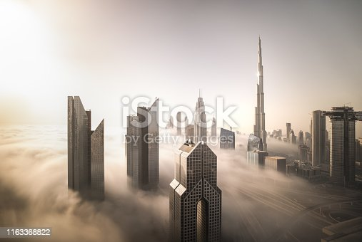 512697874 istock photo Dubai Downtown skyline on a foggy winter day. 1163368822