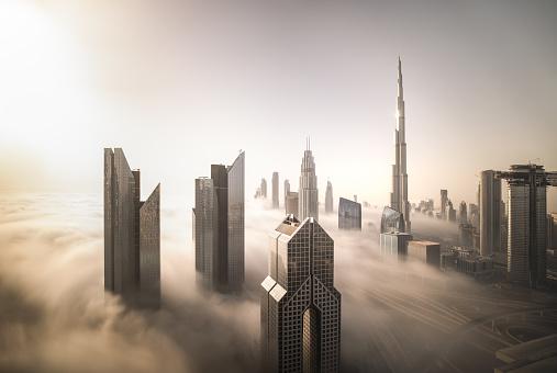 istock Dubai Downtown skyline on a foggy winter day. 1163368822