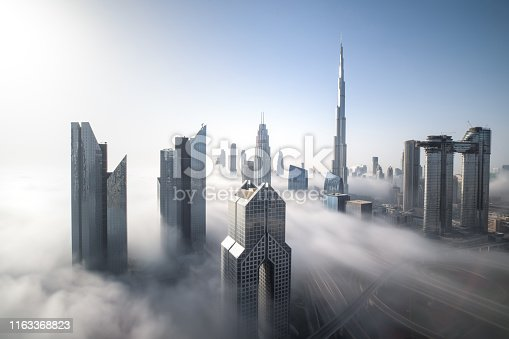 Cityscpae of Dubai Downtown skyline on a foggy winter day. Dubai, UAE.