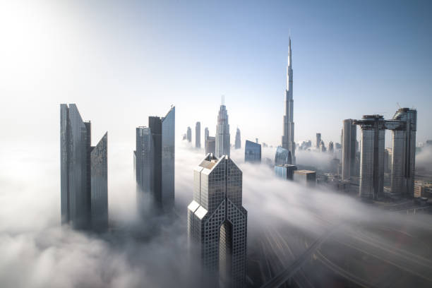 Dubai Downtown skyline on a foggy winter day. Cityscpae of Dubai Downtown skyline on a foggy winter day. Dubai, UAE. skyscraper stock pictures, royalty-free photos & images