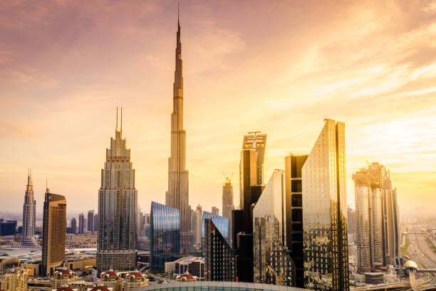 Dubai downtown skyline View of Dubai downtown skyline at sunset burj khalifa stock pictures, royalty-free photos & images