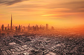 Aerial view of downtown Dubai in United Arab Emirates. Foggy sand storm day over the tall skyscrapers and office buildings on Sheikh Zayed Road.