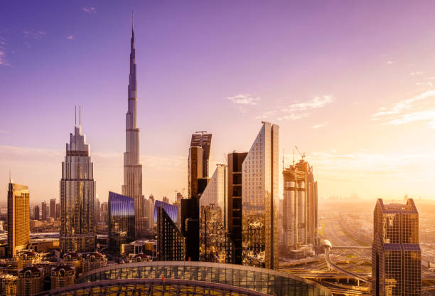 Dubai downtown skyline View of Dubai downtown skyline at sunset dubai stock pictures, royalty-free photos & images