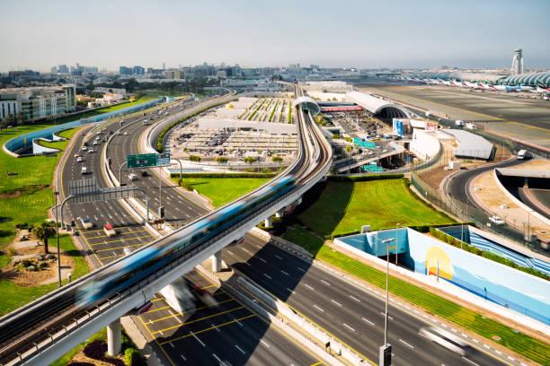 Dubai International Airport and metro at sunny day. stock photo