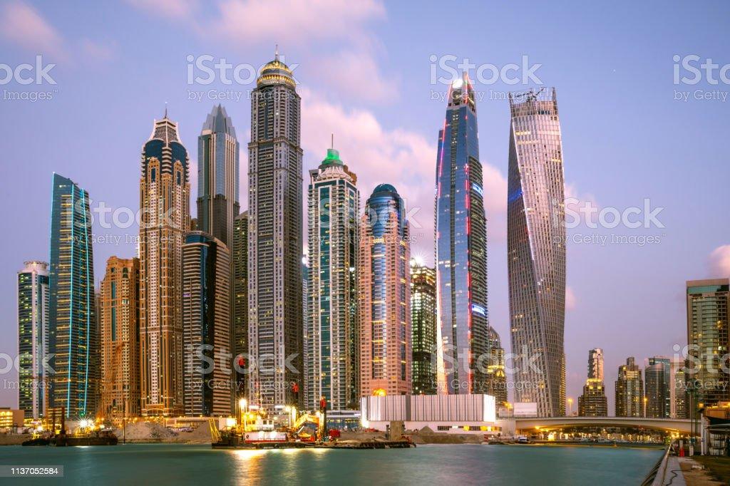 Dubai Marina business city skyline and architecture fast growth stock photo