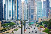 Dubai, UAE - December 7. 2019 - Dubai Marina district with a view of the skyline, main street and tram rails