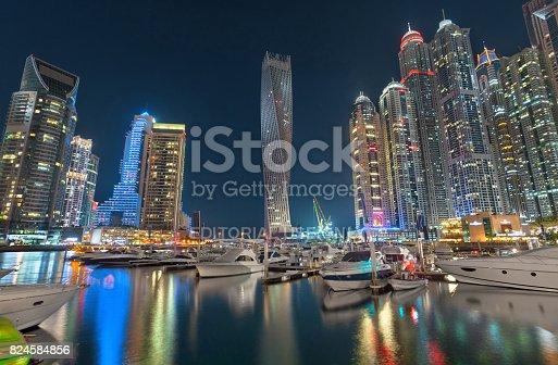 istock Dubai Marina Lights with Beautiful Skyline Reflection on Water at Night 824584856