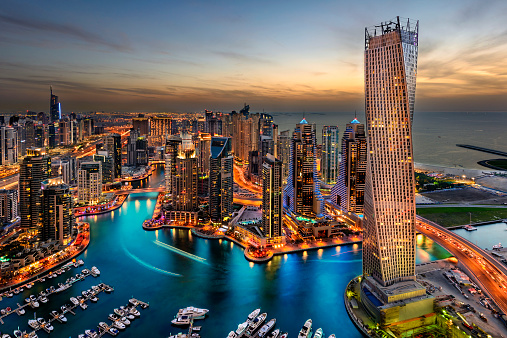 Dubai Marina from a high view showing the boats, sea, and the city scape.
