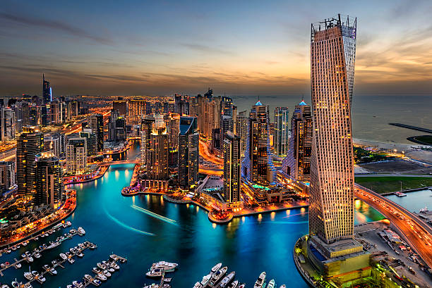 Dubai Marina Dubai Marina from a high view showing the boats, sea, and the city scape. dubai stock pictures, royalty-free photos & images
