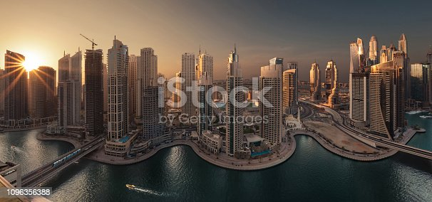 Dubai Marina Towers Panorama in a Beautiful Golden Sunset with Sun Lens Flare on the left