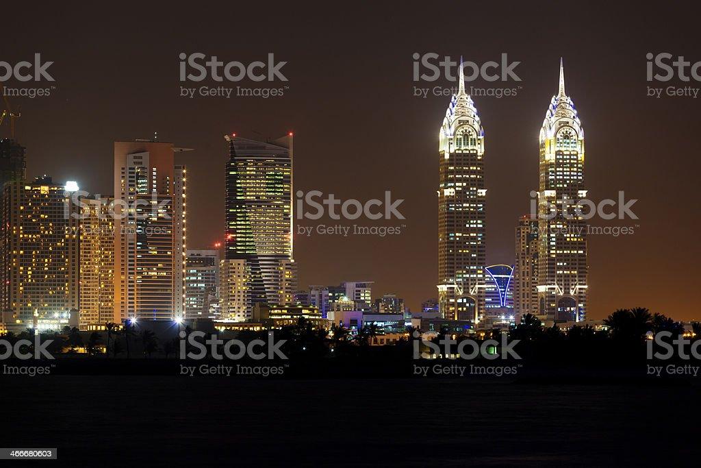 Dubai media City by night stock photo