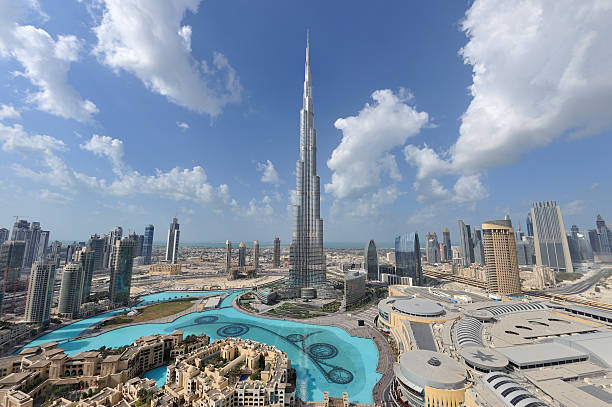 dubai mega city Dubai continue to attract millions of visitors every year to admire the wonder of the city and mega shopping malls.  This view is no longer possible as it was taken from the Address Hotel. burj khalifa stock pictures, royalty-free photos & images