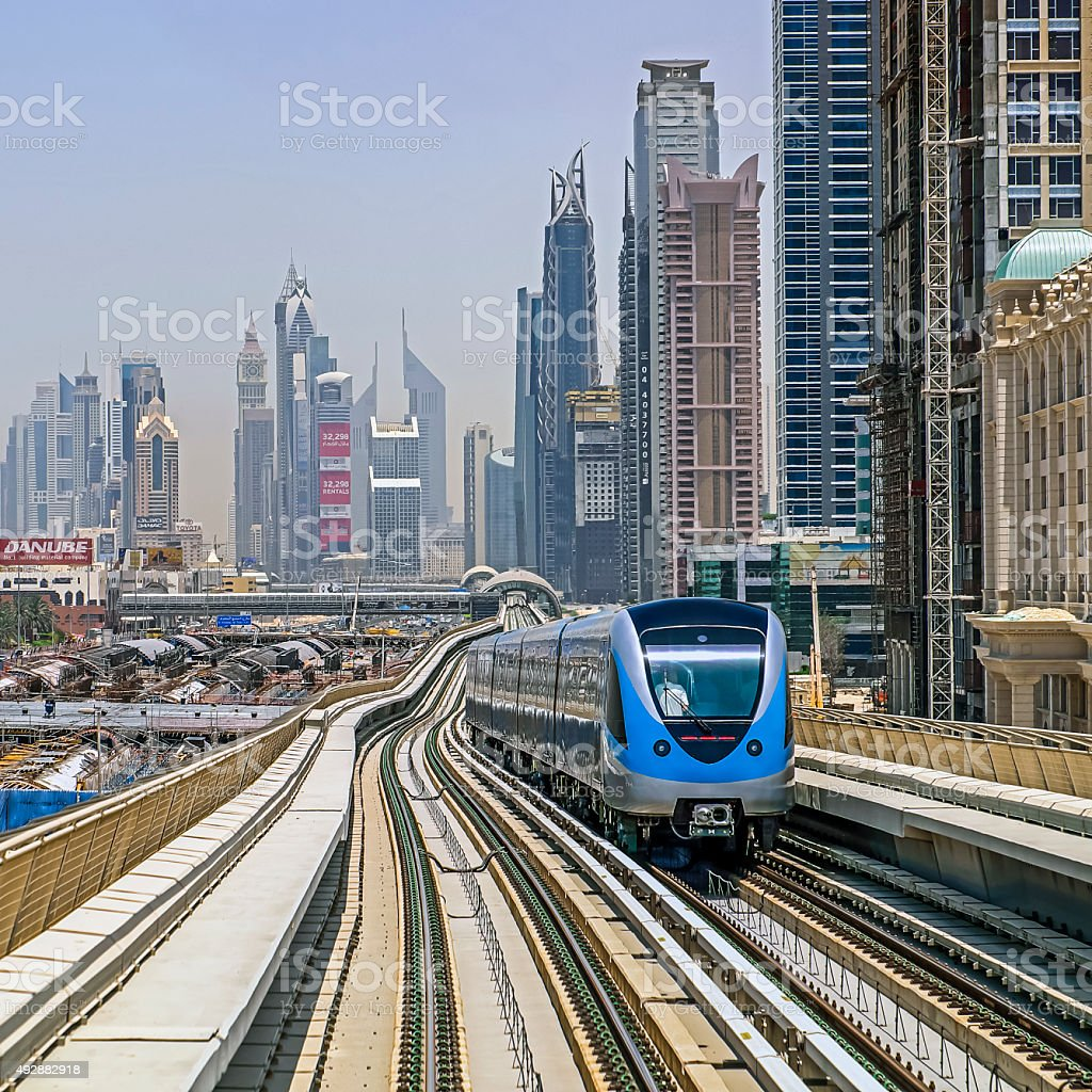 Dubai Metro auto train with city skyscrapers in background stock photo
