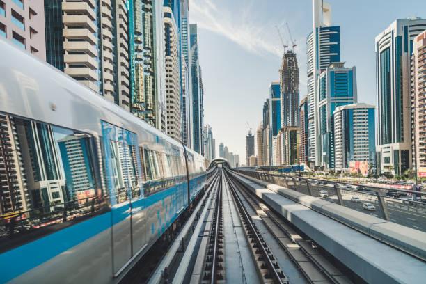 POV Dubai Metro Riding through Downtown stock photo