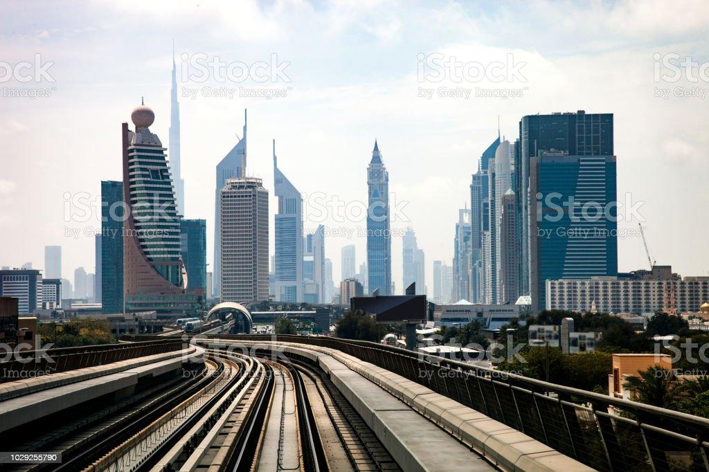 Dubai metro subway station and city downtown skyline stock photo